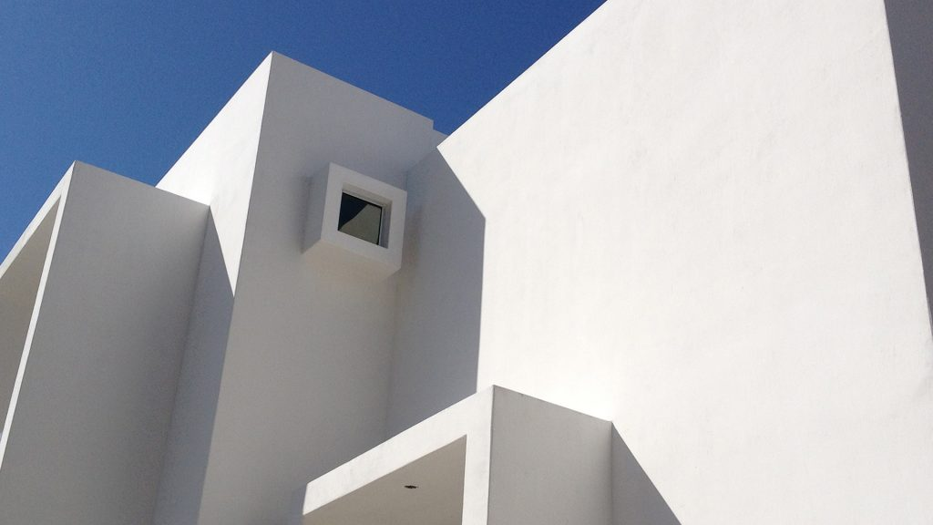 Clean white exterior of architect-designed house